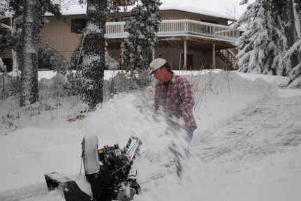 My dad snowblowing the driveway after one of our bigger storms last winter.